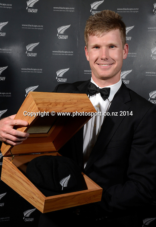 James Neesham poses for a picture with his Test Cap at the 2013/14 New Zealand Cricket Annual Awards dinner at the Langham Hotel in Auckland, New Zealand. Photo: Andrew Cornaga/www.Photosport.co.nz