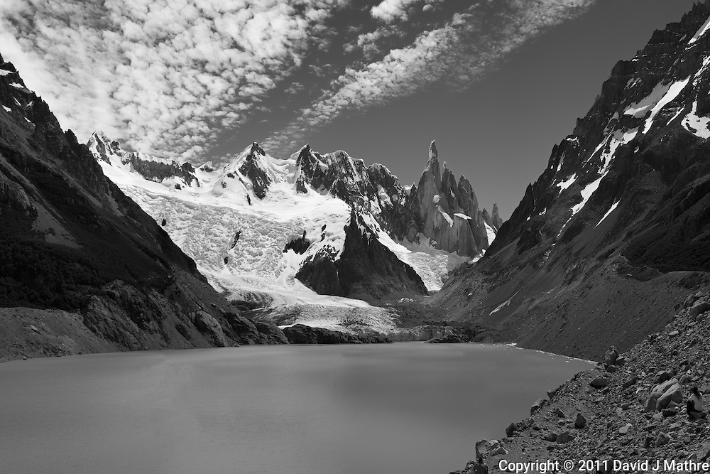 Panorama of Laguna Torre taken on a hike from El Chalten in Parque Nacional Los Glaciares while on a Photography Workshop in Patagonia with Thom Hogan. Composite of 4 mages taken with a Nikon D3x and 50 mm f/1.4G lens (ISO 100, 50 mm, f/11, 1/40 sec). Converted to B&W with Nik Silver Efex Pro. .