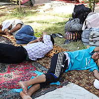 Syrian refugees sleep outdoors at a makeshift campsite in Qushtapa Park in Qushtapa, Iraq outside of Erbil in Iraqi Kurdistan, Friday, August 30, 2013.  August 2013.