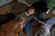 Kathy Bowler poses for a portrait with four of her dogs, from left, Liam, Indy, Quincy, and Brogan at her home in Sacramento, California, March 17, 2013.