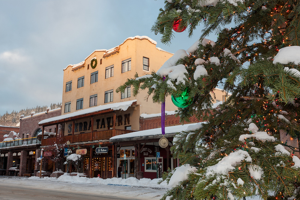 """Snowy Christmas Tree in Truckee 6"" - This snow covered Christmas tree was photographed in Downtown Truckee, California with the Sierra Tavern in the background."