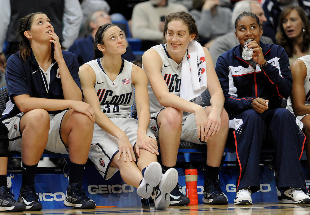 Connecticut's Stefanie Dolson, left, Kelly Faris, second from left, Breanna Stewart, second from right and Kaleena Mosqueda-Lewis, right, react in the final minutes of the second half of a NCAA college basketball game in Hartford, Conn., Wednesday, Nov. 28, 2012. Connecticut won 101-41. (AP Photo/Jessica Hill)