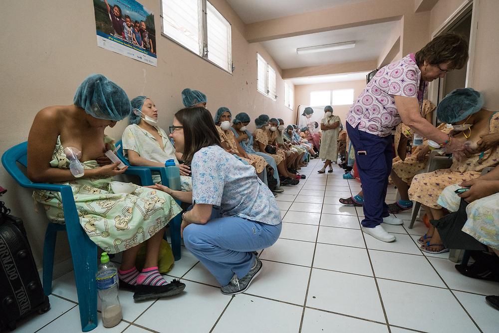Mandy Ivanov and Heidi Unziker help teach new mothers how to operate donated breast pumps at Occidente Hospital in Santa Rosa de Copan, Copan, Honduras Feb. 28, 2017. Photo Ken Cedeno
