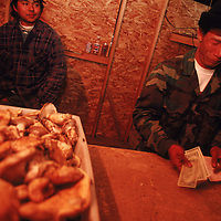 Matsutake mushroom pickers check receipts and cash after selling their harvests in Crescent Lake Junction, Oregon. Because all of the transactions are in cash, everyone is fearful that the IRS will be notified of the unreported income. Each day, over $200,000 is reportedly filtered though a tiny bank in a nearby town. Each night, trucks leave Crescent Lake Junction hauling cargoes worth six figures. State and Federal tax authorities recently initiated an inquiry into the money the harvest has generated over the last two years.