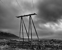 Twin-Tripods. Powerlines from a Bus on a Winter Day in Iceland. Image taken with a Leica X2 camera (ISO 100, 24 mm, f/4.5, 1/250 sec). Raw image processed with Capture One Pro and Google Silver Efex Pro.