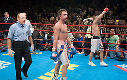 June 10, 2006 - New York, NY - WBO Champion Miguel Cotto (r) celebrates after his 12 round Junior Welterweight Championship bout against Paulie Malignaggi at Madison Square Garden.  Cotto retained his title via 12 round unanimous decision.