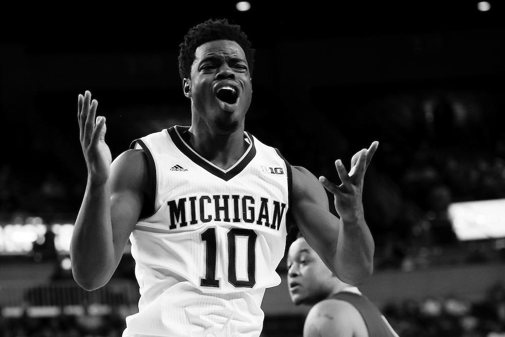Nov 13, 2015; Ann Arbor, MI, USA; Michigan Wolverines guard Derrick Walton Jr. (10) reacts against Northern Michigan Wildcats at Crisler Center. Mandatory Credit: Rick Osentoski-USA TODAY Sports
