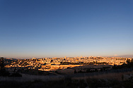 Morning sun illuminates the Old City of Jerusalem, with the New City visible in the background, in this wide-angle view from the Mount of Olives. WATERMARKS WILL NOT APPEAR ON PRINTS OR LICENSED IMAGES.