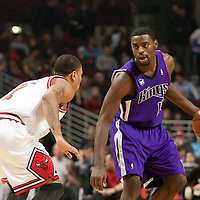 21 December 2009: Sacramento Kings guard Tyreke Evans looks for a teammate while Chicago Bulls guard Derrick Rose defends on him during the Sacramento Kings 102-98 victory over the Chicago Bulls at the United Center, in Chicago, Illinois, USA.