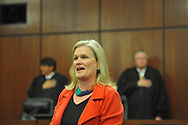 Jean Jordan sings the national anthem at a Naturalization Ceremony at the U.S. District Court in Oxford, Miss., on Thursday, December 20, 2012.