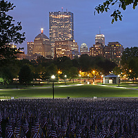 Boston photography from New England based fine art photographer Juergen Roth showing the Garden of American Flags in the Boston Common on Memorial Day 2014. The Military Heroes Garden of American flags in Boston Common displays nearly 37,000 American flags, each flag represents the lost life of a fallen service member from Massachusetts since the Revolutionary War (1775 - 1783) to the present in 2014. Visitors are reminded of the essence of the Memorial Day holiday through this deeply moving site.<br />