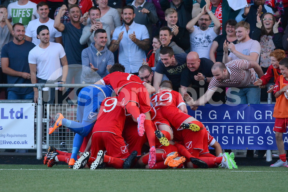 Newtown players celebrate their winning goal scored by Jason Oswell during the Europa League Qualifying match between Newtown AFC and Valletta FC at Paveways Latham Park Stadium, Newtown, Powys, Wales on 2 July 2015. Photo by Garry Griffiths.