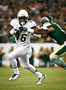 SHOT 9/19/15 7:06:22 PM - Colorado's Christian Powell #46 tries to shed the tackle a Colorado State defender during the Rocky Mountain Showdown at Sports Authority Field at Mile High in Denver, Co. Colorado won the game 27-24 in overtime. (Photo by Marc Piscotty / © 2015)