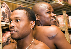 July 6, 2006 - New York, NY - Former Welterweight champions Ike Quartey (l) and Vernon Forrest (r) pose in the meat locker of Gallagher's Steakhouse before announcing their upcoming August 5, 2006 fight at the Theater at Madison Square Garden.