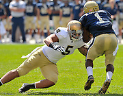 Linebacker Manti Te'o (5) gets a hit on Pitt's Ray Graham at Heinz Field.