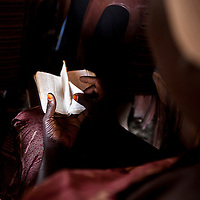 A woman reads a bible in Arabic in a church in Abyei.