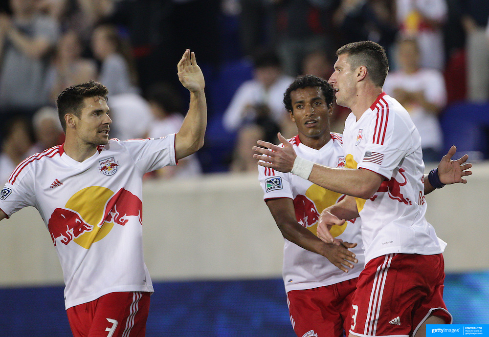 New York Red Bulls player Kenny Cooper (right) is congratulated by team mates after scoring during the New York Red Bulls V Chivas USA Major League Soccer match at Red Bull Arena, Harrison, New Jersey, 23rd May 2012. Photo Tim Clayton