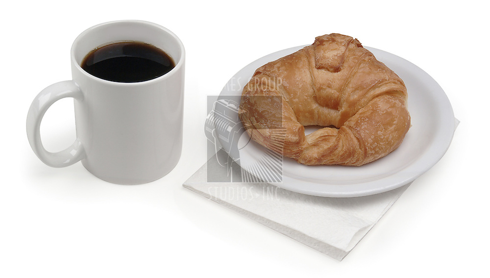 Coffee and croissant on white