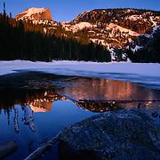 Hallett's Peak reflects in Bear Lake at dawn, winter, Rocky Mountain NP, CO.