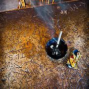 Funky table with smoking cigarette in Gruene Music Hall in Gruene, Texas USA.