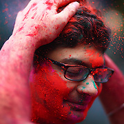 A participants has gulal, or powdered color, dumped on his head during a Holi festival at the Sanatan Dharma Hindu Temple and Cultural Center in Maple Valley on Saturday, March 10, 2012. Holi, the Festival of Colors, is a Hindu festival welcoming spring. It is most well-known for the vibrant bursts of gulal, the powdered dye, that festivalgoers throw on each other. (Joshua Trujillo, seattlepi.com)