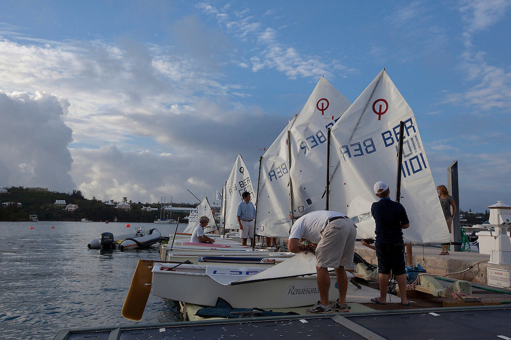 Junior Gold Cup sailors prepare their Optimist dinghies early in the morning during the Argo Group Gold Cup 2010. Hamilton, Bermuda. 7 October 2010. Photo: Subzero Images/WMRT