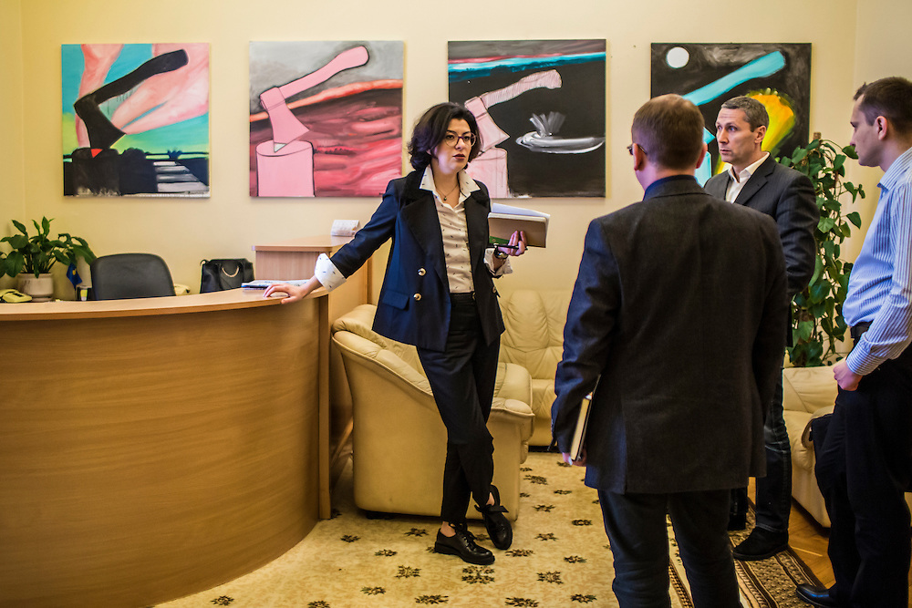 KIEV, UKRAINE - MARCH 4, 2016: Oksana Syroyid, left, deputy speaker of the Ukrainian parliament, talks with staff after a meeting in her office in Kiev, Ukraine. Syroyid is one of parliament's main opponents of the constitutional reforms called for in the Minsk agreement intended to resolve fighting in eastern Ukraine. CREDIT: Brendan Hoffman for The New York Times
