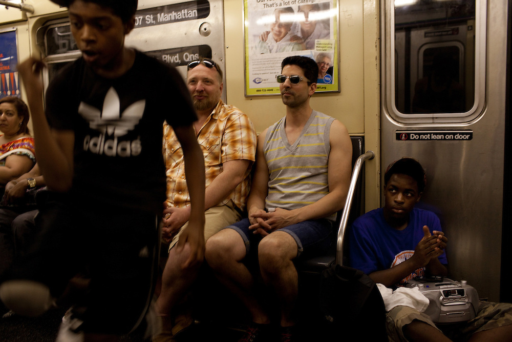 Boys dance on the A train heading through Brooklyn on June 24, 2012.
