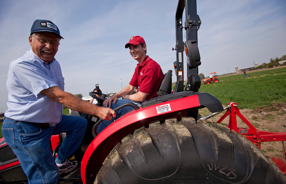 St.Thomas, Ontario ---10-09-21--- Ontario Premier Dalton McGuinty and local farmer George Beaudry share a laugh as they plow a field at the 2010 International Plowing Match in St. Thomas, Ontario, Tuesday, September 21, 2010.<br /> GEOFF ROBINS The Globe and Mail