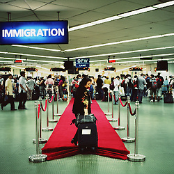 The Overseas Workers Welfare Administration, OWWA, rolled out the red carpet for the roughly 120,000 OFWs that came home for the Christmas season in Manila, Philippines on Dec. 2006.  Even President Gloria Macapagal-Arroyo took time out of her busy schedule to greet returning OFWs at the Ninoy Aquino International Airport.
