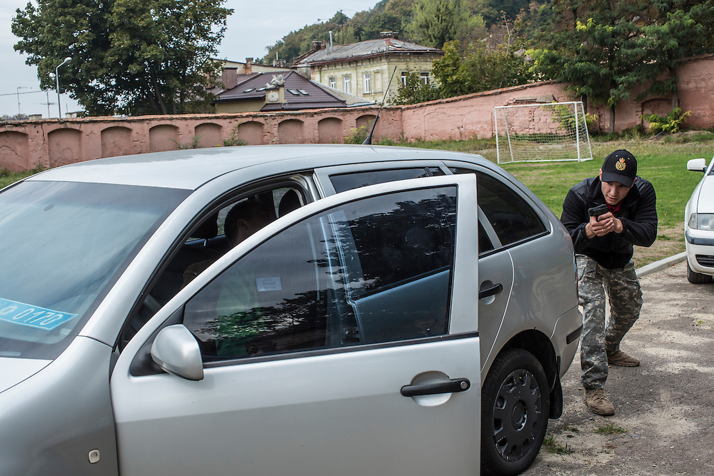 LVIV, UKRAINE - OCTOBER 5, 2015: Instructor Pavlo Besaga, right, teaches recruits how to apprehend a suspect during a traffic stop during tactical training for new patrol police officers in Lviv, Ukraine. In an effort to reform the notoriously corrupt Ukrainian police force, an entirely new force has been established in several cities, including Kiev and Lviv, with a primary focus on patrolling the streets. CREDIT: Brendan Hoffman for The New York Times
