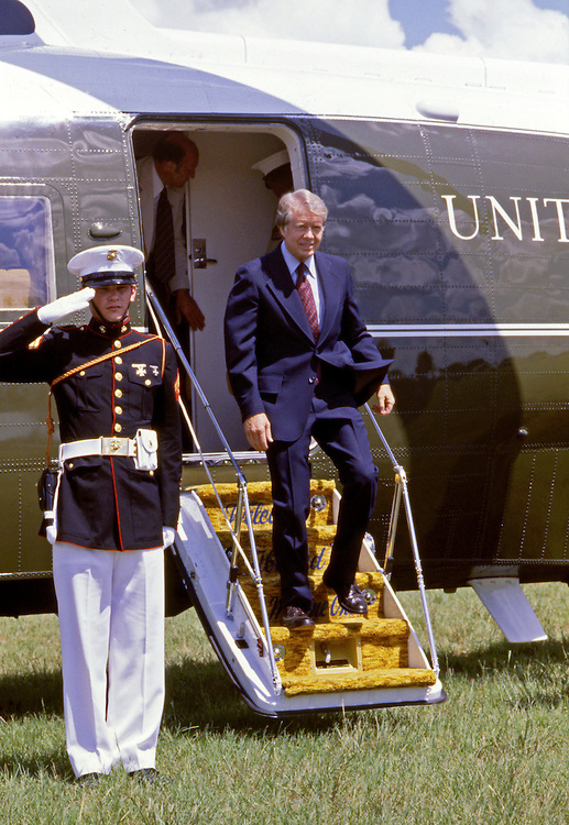 President Jimmy Carter exits Marine One on the south lawn of the White House - To license this image, click on the shopping cart below -