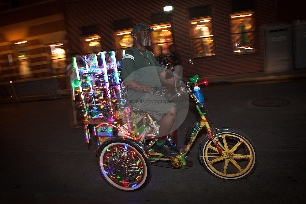 A decorated and light tricycle parades down Duval Street during the annual Halloween Fantasy Fest in Key West, Florida.
