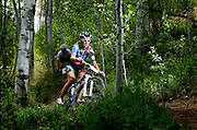 SHOT 6/5/10 12:19:11 PM - Heather Irmiger of Boulder, Co. competes in the women's pro category in the Volvo X Country Mountain Bike race at the Teva Mountain Games in Vail, Co. Irmiger finished third in the event  and is the 2009 U.S. XC and Marathon National Champion as well as Single Speed World Champion. The games attract some of the world's best extreme athletes to compete in kayaking, climbing, mountain bike racing, freeride, big air, trail and road running and dog competitions. (Photo by Marc Piscotty / © 2010)