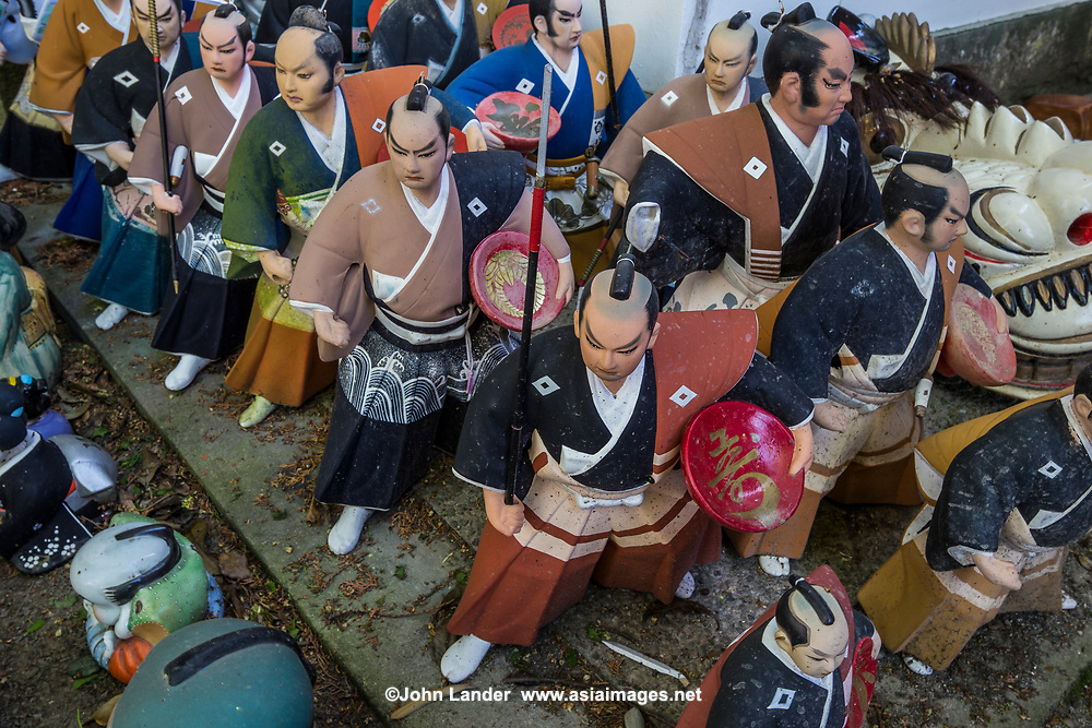 Samurai Warrior Dolls at Awashima Shrine - Awashima Jinja is a shrine for women, famous for its huge collection of dolls. Japanese are superstitions about dolls, many people find them mysterious or frightening, believing that they have souls or the power to influence human lives. There are a number of shrines and festivals where people dispose of their old dolls - they feel that if they just threw them in the garbage, the dolls' souls might come back to haunt them like ghosts. Awashima jinja is especially devoted to dispose of hina ningyo, which are dolls that are given to young girls on Girl's Day March 3rd. There are thousands of dolls here, as well as sculptures, figurines, carvings, and statues. You'll find tanuki, maneki neko, daruma, frogs and many more.