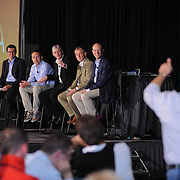 A conference attendee asks the panel a question during a Q&A session at the Microsoft West Coast Partners conference at the Los Angeles Convention Center. Event photography by Dallas event photographer William Morton of Morton Visuals.