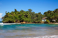 House in a bay east of Maguana, Baracoa, Guantanamo Province, Cuba. The family raises pigs and spear fish for a living.
