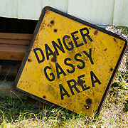"""A """"DANGER GASSY AREA"""" sign marked propane storage at the former John Fluke vacation property on Vendovi Island, Skagit County, Washington, USA. Vendovi Island was named after a Fijian High Chief Ro Veidovi who was brought to North America by the 1841 Wilkes Expedition. The San Juan Preservation Trust, a land trust for conservation in the San Juan Islands, purchased the island in December 2010 from the family of John Fluke Sr. Vendovi Island lies across Samish Bay from mainland Skagit County, between Guemes Island and Lummi Island, in the Salish Sea."""