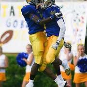 Blue cornerback Andre Patton (8) of Saint Elizabeth High School celebrates with teammate Jeffery May (3) of Hodgson Vocational High School after Patton intercepted a pass in the first quarter of the 58th Annual DFRC Blue-Gold All-Star Football game Saturday, June. 22, 2013, at Delaware Stadium in Newark DE.