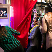 03/19/2014- Stevens Point, Wisc. - The women's basketball team crams in to a photo booth during the team social event for the NCAA Division III Women's Final Four on Mar. 19, 2014. (Kelvin Ma/Tufts University)