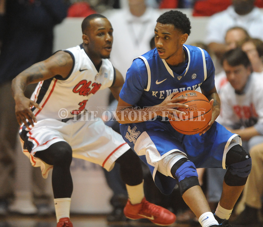 """Kentucky's Ryan Harrow (12) works against Mississippi's Derrick Millinghaus (3) at the C.M. """"Tad"""" Smith Coliseum on Tuesday, January 29, 2013.  (AP Photo/Oxford Eagle, Bruce Newman).."""