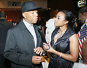 l to r: Russell Simmons and Tatiana at The HipHop Inagual Ball Hennesey Lounge held at The Harman Center for the Arts in Washington, DC on January 19, 2009..The first ever Hip-Hop Inaugural Ball, a black tie charity gala, benefiting the Hip-Hop Summit Action Network. The Ball will kick off with a star-studded red carpet presentations of the National GOTV Awards, recognizing artists who have made outstanding contributions to the largest young adult voter turnout in American history.