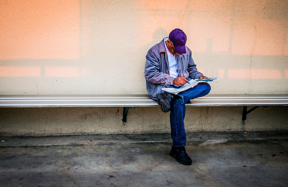 A handicapper studys the final races on December 21, 2013 at Betfair Hollywood Park in Inglewood, California . The Track is set to close permanently on December 22, 2013 after operating since 1938 (Alex Evers/ Eclipse Sportswire)