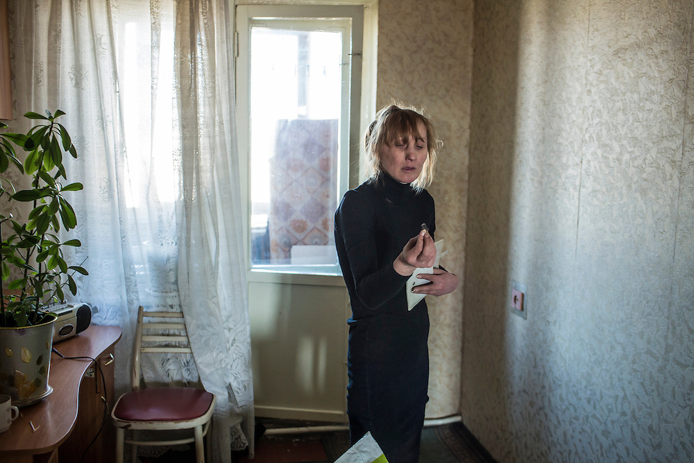 Olga holds a piece of shrapnel that came through her window when on January 24 shelling hit her neighborhood of Vostochniy on Monday, March 9, 2015 in Mariupol, Ukraine. Photo by Brendan Hoffman, Freelance