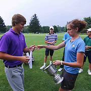 Reed Winkler (LEFT) accepts a medal and trophy after winning the boys 2015 Delaware junior championship at Chesapeake Bay Golf Club Thursday, July 03, 2015, in Rising Sun, Maryland.