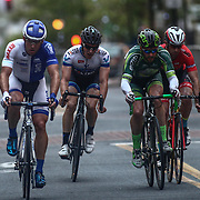 Eventual winner Brad White, left, take the lead during the Men's Pro, category I (35 miles) race Saturday, May 14, 2016, in Wilmington Delaware.