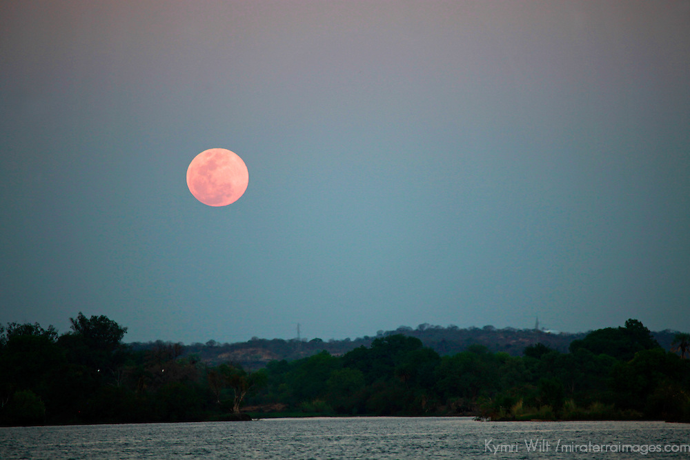 Africa, Zimbabwe, Victoria Falls. Full Moon over the Zambezi River.