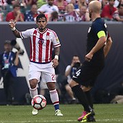 Paraguay Midfielder VICTOR AYALA (20) dribbles down the field as United States Midfielder MICHAEL BRADLEY (4) defends in the first half of a Copa America Centenario Group A match between the United States and Paraguay Saturday, June. 11, 2016 at Lincoln Financial Field in Philadelphia, PA.