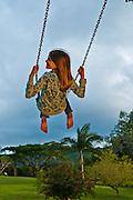 Girl having fun on a backyard swing