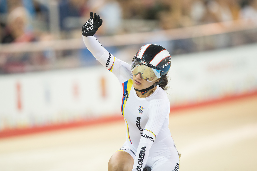 Juliana  Gaviria Rendon of Colombia celebrates her bronze medal win in the women's cycling sprint finals at the 2015 Pan American Games in Toronto, Canada, July 19,  2015.  AFP PHOTO/GEOFF ROBINS
